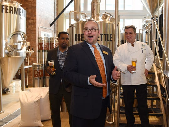 From left, Garrett Oliver brewmaster, Brooklyn Brewery, Stephan Hengst, director of communications for the Culinary Institute of America, and Waldy Malouf, senior director of special projects for the CIA during the opening of the CIA's brewery on Friday.