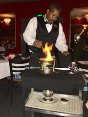 Flaming Cherries Jubilee is prepared and served right at your table.
