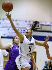 Piedra Vista's Alexis Long goes for a layup against Miyamura on Nov. 19 at the Jerry A. Conner Fieldhouse.