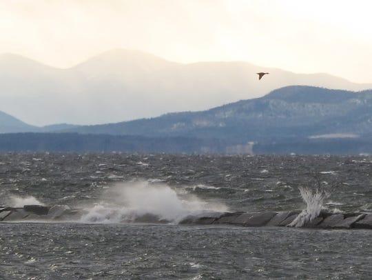Wind-driven waves crash against the Burlington breakwater