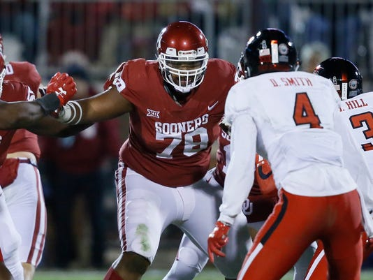 FILE - In this Oct. 28, 2017, file photo, Oklahoma offensive lineman Orlando Brown (78) blocks against Texas Tech during the second half of an NCAA college football game in Norman, Okla. Oklahoma left tackle Orlando Brown always wanted to be better than his dad. Orlando Sr., started 119 NFL games. Junior is on track to getting there he's a first-team All-American who is expected to go in the first round of the NFL Draft if he leaves early.  (AP Photo/Sue Ogrocki, File)