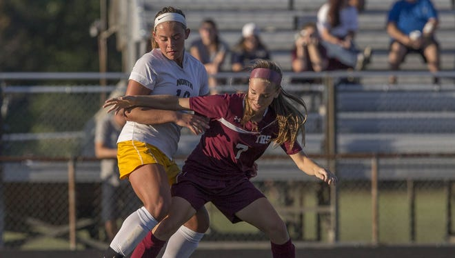 Toms River North's Marisa Tava and  Toms River South's Emily Donzanti battle for ball durin first half action in Toms River South vs Toms River North Girls Soccer at Toms River North on September 22, 2016.