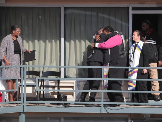 Rev. William Barber gets a hug as he prepares to address the crowd outside the Lorraine Motel and National Civil Rights Museum during the commemoration ceremony for the 50th Anniversary of Martin Luther King Jr.'s assassination Wednesday, April 4, 2018, in Memphis, Tenn.