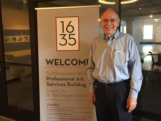 Guardian Fine Art Services owner John Shannon stands