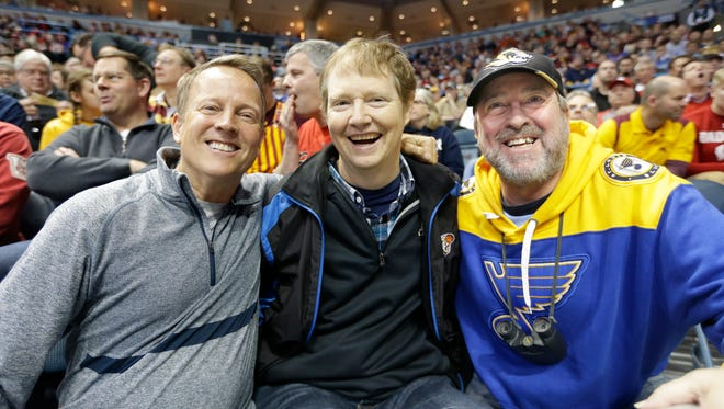 Longtime friends and NCAA tournament fanatics (from left) Jim Wikman, 61, Tom Bowen, 53, and John Ries, 57, pose for a photo during a game at the Bradley Center Thursday.