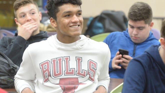 Jalen Oliver smiles during a ceremony honoring Drew Pyle's commitment to pitch for IPFW, Emilee Thackrey's commitment to play golf at Indiana University East, and Kaleb Slagle's commitment to run cross country at Evansville Tuesday, Nov. 14, 2017.