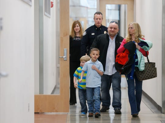 Callin Prieskorn of Waukee arrives Tuesday, March 14, 2017, at the Johnston Police Department with his wife, April, right, and children Shawn Prieskorn, 5, and Helo Nong, 7, to reunite with the officer that arrested him for drunk driving 10 years ago.