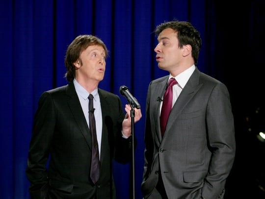 Sir Paul McCartney, left, sings with Jimmy Fallon on Dec. 9, 2010.
