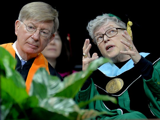 MSU President Lou Anna Simon and George Will confer at commencement Saturday, December 13, 2014.