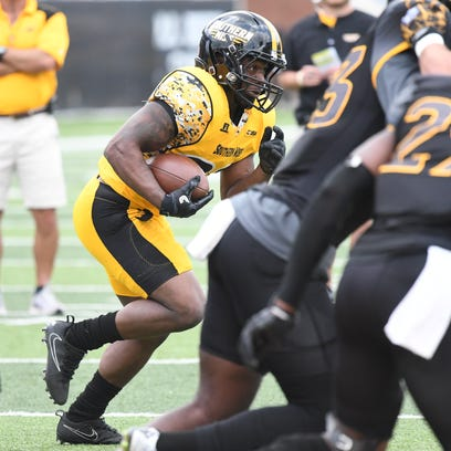 Southern Miss running back T'Rod Daniels runs with
