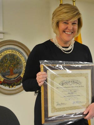 Mayor Colleen Mahr holds her certificate of election after a presentation at a borough council meeting in Fanwood, NJ, Friday, Jan. 1. Mahr was sworn in for an unprecedented fourth term as Fanwood's mayor.