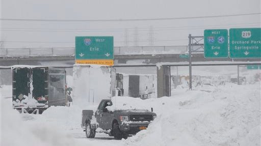 Heavy snow off Lake Erie south of Buffalo forced a temporary closure of the Thruway near the Pennsylvania state line.