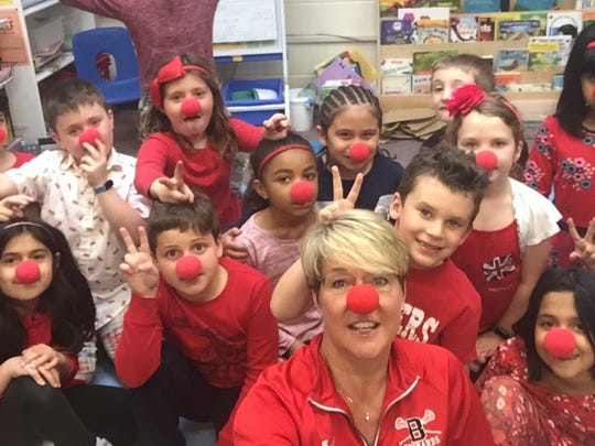 Students, teachers and staff at Bayberry School held their own Red Nose Day fundraiser to help end childhood hunger and poverty in the U.S. and around the world. The school raised over $1,000 on May 25. Pictured are Judy Wall's (botton center) with first-grade students.