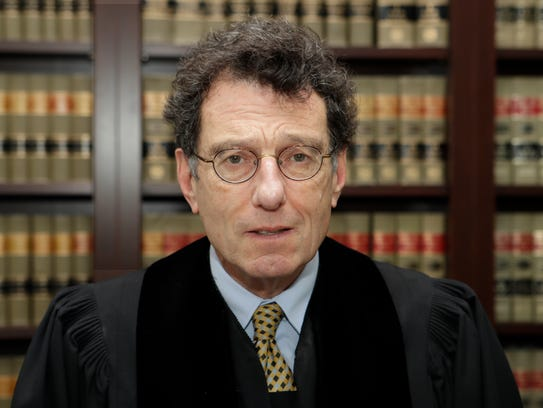 """U.S. District Judge Dan Polster has called the opioid addiction epidemic """"100 percent man-made"""" and asserted that other branches of government have """"punted"""" on solving it."""