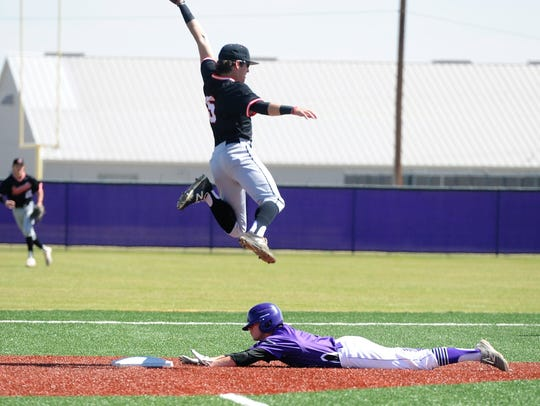 Wylie's Brady Horn (9) slides under Aledo's Hunter