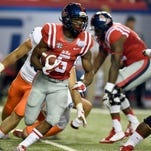 Ole Miss running back I'Tavius Mathers carries the ball against the Boise State defense at the Chick-fil-a Kickoff Game in the Georgia Dome.