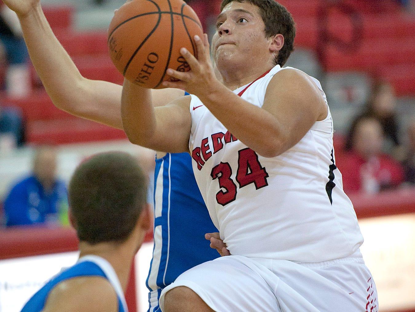 Bucyrus guard Zane Richardson attempts a basket.