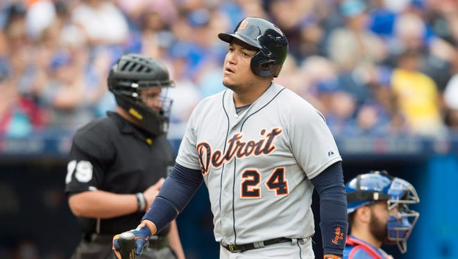 Tigers first baseman Miguel Cabrera reacts after striking out in front of Blue Jays catcher Russell Martin during the eighth inning of the Tigers' loss Saturday in Toronto.