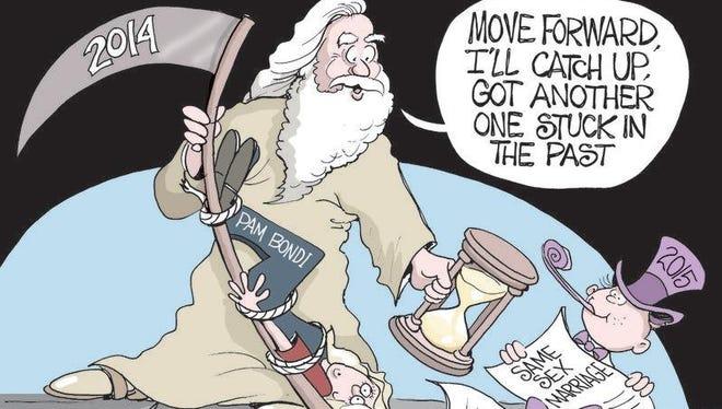 Sunday, Dec. 28, 2014 editorial cartoon.