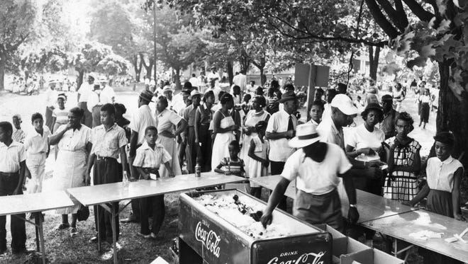 In this undated historic photo, black DuPont employees and families gather for a company picnic at Montgomery Hall Park. File/Submitted DuPont employees and families gather for the DuPont picnic at Montgomery Hall Park.