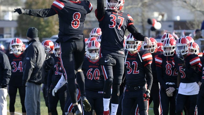 Changes could be coming to the structure of high school football in Massachusetts as the MIAA Football Committee discussed a proposal on Wednesday morning to change the playoff format. A year ago, Old Rochester's Chase Johnson, right, has a high five for Thomas Durocher after his touchdown run over Norwell during the Division 6 South Semifinals held at Old Rochester.