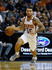 Phoenix Suns guard Mike James (55) dribbles the ball against the Chicago Bulls during the first half of an NBA basketball game Sunday, Nov. 19, 2017, in Phoenix.