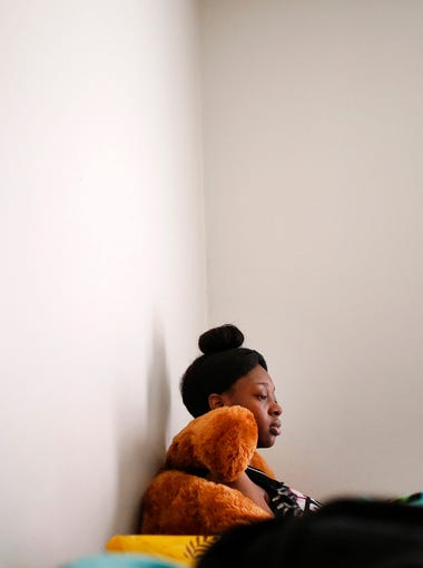 "On a dreary day on the second week of her spring break from Ben Davis High School, De'Janae sits in her bed waiting for a doctors appointment. Simpson admits she hasn't been eating the best lately. ""I have a snack shelf in my closet,"" she said. ""I've really been craving sour candy and hot chips."""