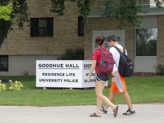 Students pass in front of Goodhue Hall, which includes the University of Wisconsin-Whitewater police department. The campus is one of three UW System four-year campuses that acknowledge using students to buy drugs from others in controlled buys.