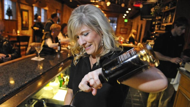 Kayla Sather mixes a drink at the Red Carpet Martini Lounge, which will host a local cocktail contest Monday.