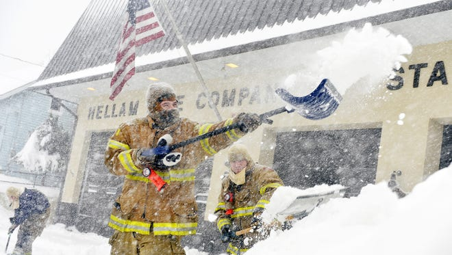 Hellam Fire Company volunteer firefighters Nathan Wolfgang, Cory Beaverson and Josh Sipe shovel out the company's driveway Saturday, Jan. 23, 2016.