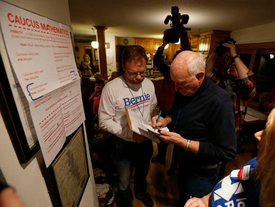 Pete Malmberg, a Bernie Sanders precinct captain (left),