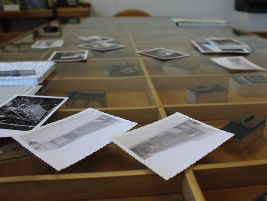 Photos of years past were scattered across the table