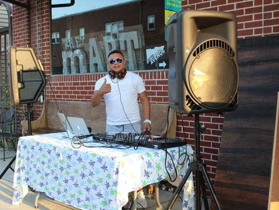 DJ Cruz of Sound Machine plays outside of the mART