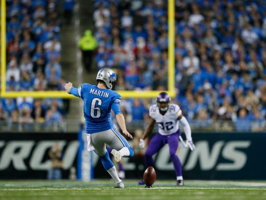 Lions punter Sam Martin kicks to the Vikings at Ford Field in Detroit on Dec. 14, 2014.