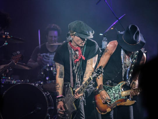 Johnny Depp and Joe Perry trading licks at Alice Cooper's