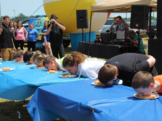 The pie eating contest is a tradition of the Red, White
