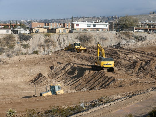 Construction of a temporary pond began Wednesday to