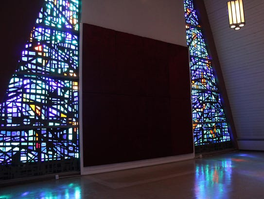 Light pours through the original stain-glass windows