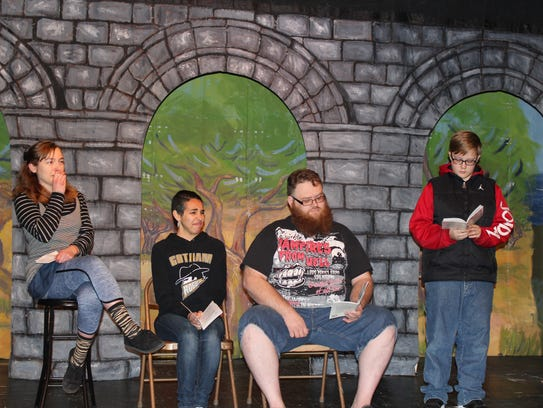 Cast members rehearse a scene from the Cumberland Players