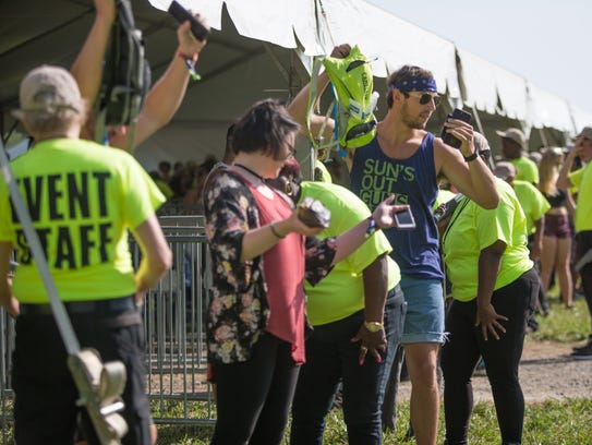 Fans go through a security check before entering Firefly