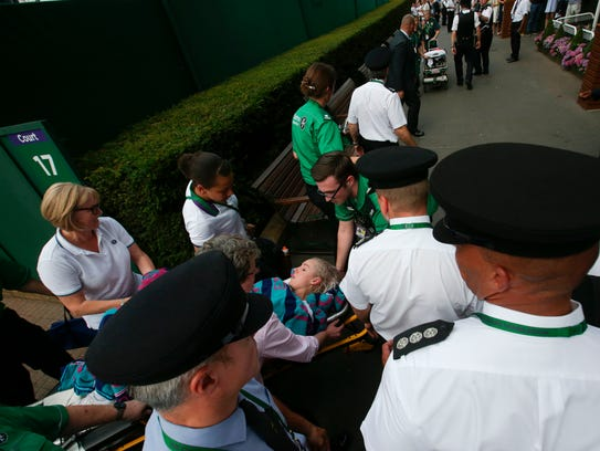 Bethanie Mattek-Sands is carried on a stretcher to