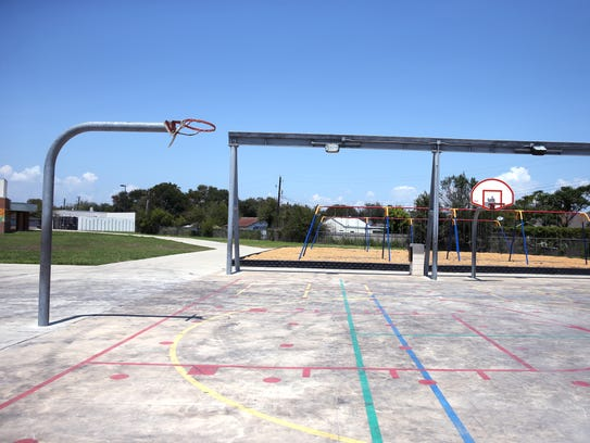 The roof is missing from the Berlanga Elementary School