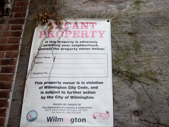 A vacant property sign hangs on a house in the 1700 block of W. 3rd St. in Wilmington.