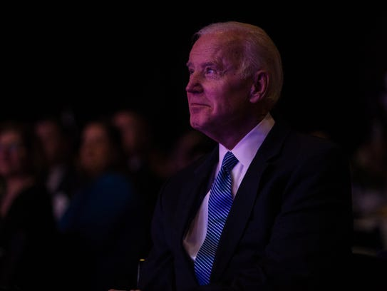 Former Vice President Joe Biden looks on as he listens to remarks from Delaware Governor John Carney during the 181st Delaware State Chamber of Commerce dinner Monday night at the Chase Center in Wilmington.