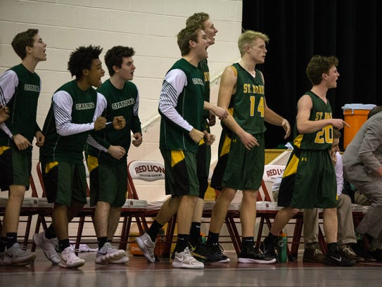 The St. Mark's bench reacts to a call by the referee