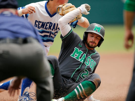 Mason's Nick Northcut (24) is thrown out at third in