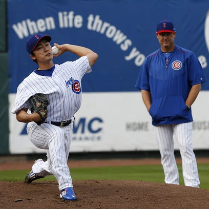 Iowa Cubs pitcher Tsuyoshi Wada warms up in the bull