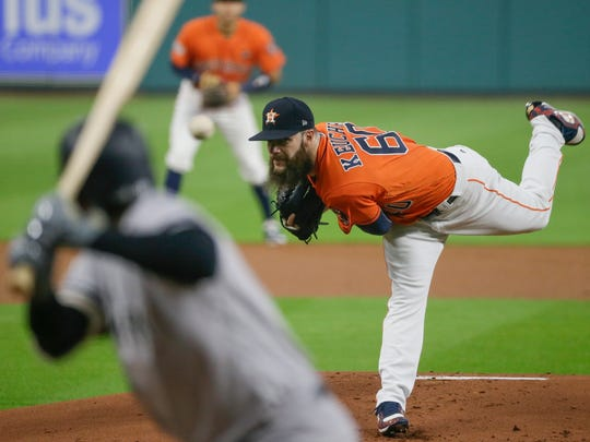 Houston Astros starting pitcher Dallas Keuchel throws during the first inning of Game 1 of baseball's American League Championship Series against the New York Yankees Friday, Oct. 13, 2017, in Houston.