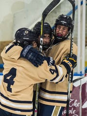 Center Essex #2 Grady Cram celebrate his goal against