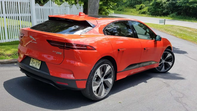 """Around back, the Jaguar I-Pace is definitely an SUV with a hatchback for better utility. The """"Pace"""" designation means the I-Pace is part of Jaguar's SUV family."""